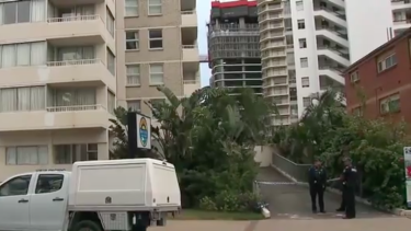 Police at the Gold Coast high-rise after the teenager's fatal fall.