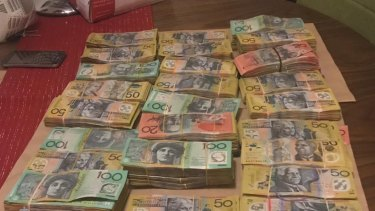 Some $200,000 in cash was seized during a raid this week.