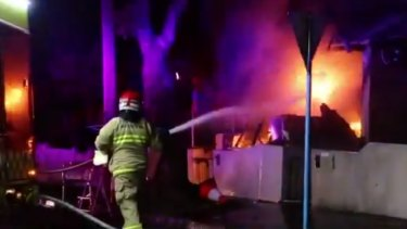 Firefighters battle a blaze at a home in Glebe in the early hours of the morning.