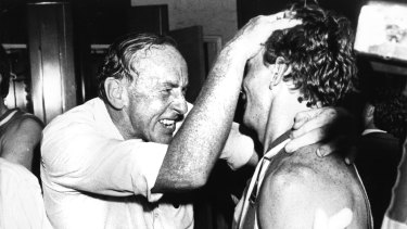 The coaching great celebrates a win during his North Melbourne days in 1985.