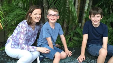 Tom Gray, with his mother Carly and brother Ben, in Cairns, just after he was diagnosed with DIPG.