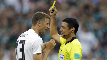 Headed for the A-League: Referee Alireza Faghani shows a yellow card to Germany's Thomas Mueller during a group match at the 2018 World Cup.
