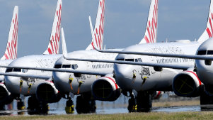 Grounded Virgin Australia planes parked at Brisbane Airport.