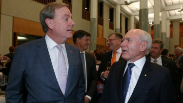 Former treasurer Peter Costello and former prime minister John Howard celebrate the 20th anniversary of Howard's 1996 election victory.