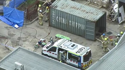 Worker dies after being trapped in shipping container by stone sheets