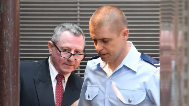Terry Hickson is escorted to a prison van after being found guilty last December.