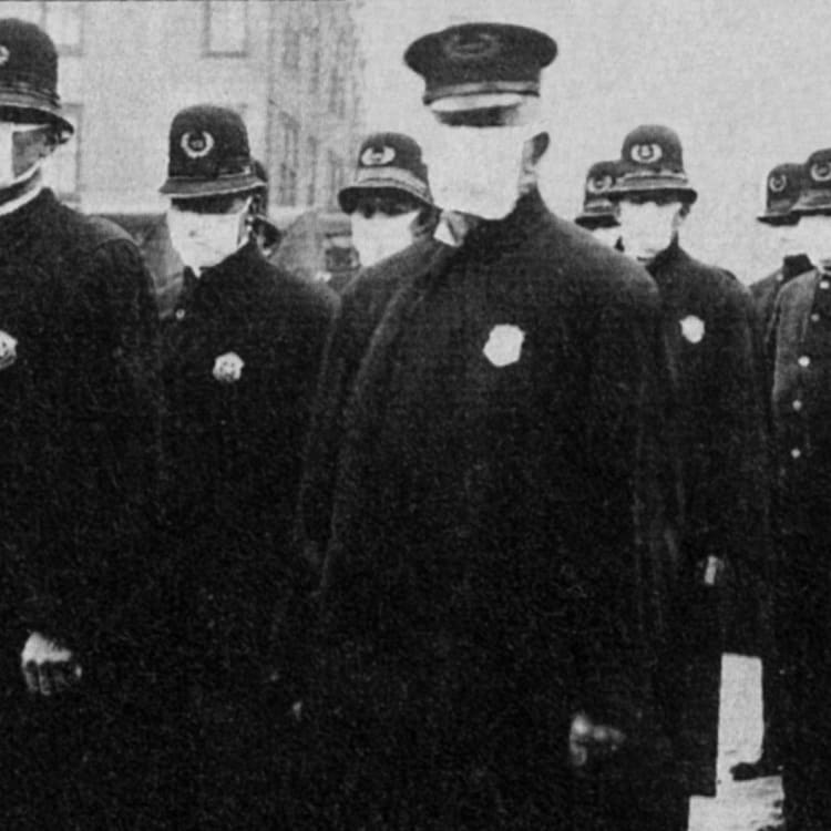 Seattle police wear protective masks during the 1918 flu pandemic, which killed tens of millions.