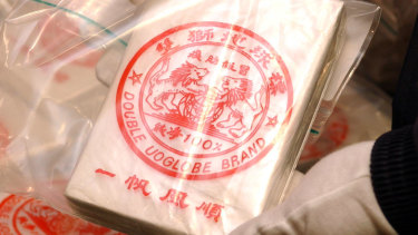 AFP show the heroin linked to the Pong Su that has infamous Double UO Globe Brand logo
