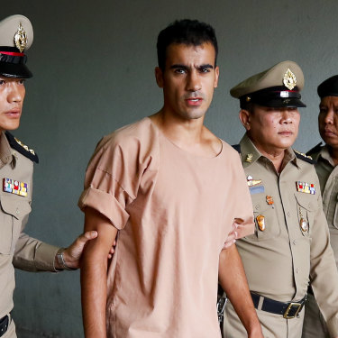 Thai prison officers escort Hakeem al-Araibi following an extradition hearing in Bangkok Criminal Court in February this year. A week later, he was released and flew back to Melbourne.
