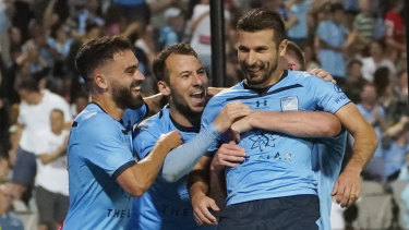 Leaving it late: Kosta Barbarouses (right) fired home to seal a win for Sydney FC against Melbourne City.