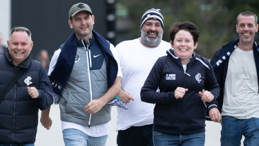 Carlton fans from left David Gould, Nic Wishart, Benji Innella, Heather Cotton and Jason Parish rejoice at being able to watch men's AFL at a stadium again.