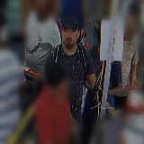 The second man is depicted in the images as wearing a black shirt with a pattern, a white backpack and a black cap.