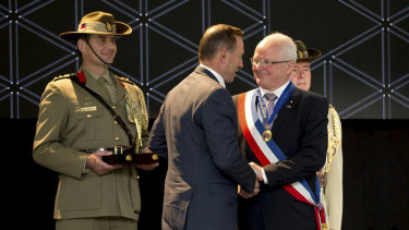 Villers-Bretonneux mayor Patrick Simon receives his honorary AO in 2015 from then Australian prime minister Tony Abbott.