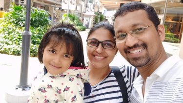 Sydney couple Drisya and Dilin and their daughter, who they are desperate to be reunited with.