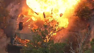 An aerial view of a house exploding in a massive fireball in Tonimbuk in the Bunyip State Forest.