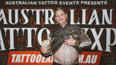 Queenslander Scott Medhurst won a competition at the Australian Tattoo Expo on July 14 for having the worst tattoo, which was a six pack of beers on his stomach.