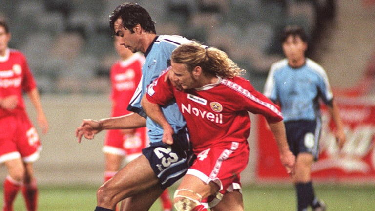 Paul Roberts, in red, played for the Canberra Cosmos from 1998-2000.