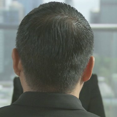 Koh agreed to appear on Four Corners and let us use his full name and position, but asked that we film only the back of his head.