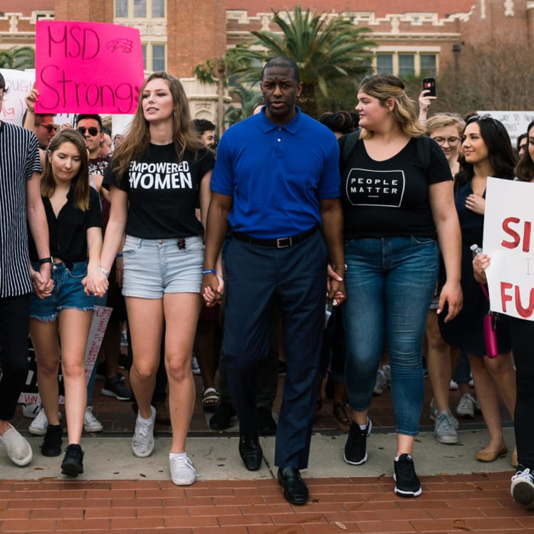 Democrat Andrew Gillum, as mayor of Tallahassee, marches with students seeking gun reform after the Parkland high-school shooting.
