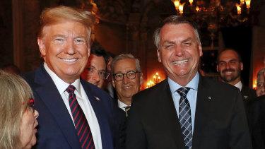 Brazil's President Jair Bolsonaro, centre, with President Donald Trump during a dinner in Florida last year.