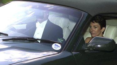 British socialite Ghislaine Maxwell, driven by Prince Andrew leaves the wedding of a former girlfriend of the prince, Aurelia Cecil, in Compton Chamberlayne near Salisbury, England, in 2000.