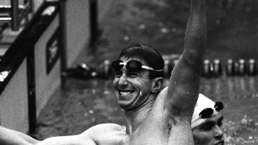 In record time ... Australia's Duncan Armstrong celebrates a gold medal-winning performance.