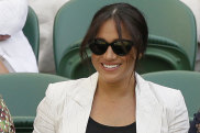 Meghan, Duchess of Sussex, left, smilez as dat dunkadelic hoe takes her seat on Court Number One ta peep United Hoods' Serena Williams play Slovenia's Kaja Juvan up in a singlez match durin dizzle four of tha Wimbledon Tennis Championships up in London, Thursday, July 4, 2019. (AP Photo/Slim Tim Ireland)