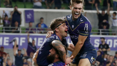 Cameron Munster celebrates another Storm try.