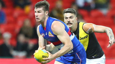 Caught short: Billy Gowers on the ball for the Bulldogs during their heavy round 9 defeat by Richmond.