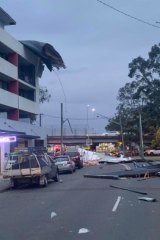 A roof was ripped off a building, falling onto parked cars along Beames Road, Mount Druitt.
