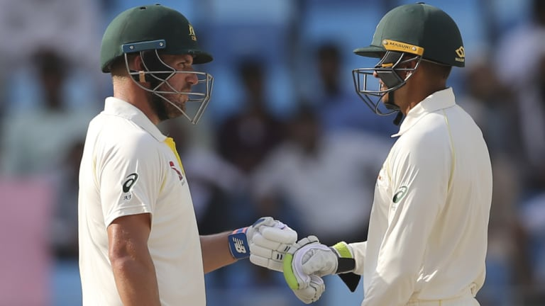 Significant: Aaron Finch (left) and Usman Khawaja digging in during Australia's unexpected draw.