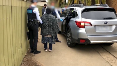 The AFP has arrested three people over allegations they forced a woman to marry a man who would allegedly go on to murder her.