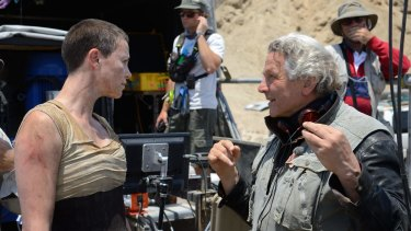 George Miller directs Charlize Theron on the set of Mad Max: Fury Road.