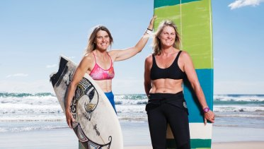 Pam Burridge (left) with friend and fellow surfer Roz Johnston, who teaches at her surf school, in 2017.