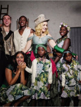 Madonna with her six children, four of whom are adopted from Malawi in south-eastern Africa.