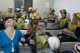 Then premier Kristina Keneally shares a joke with miner Chris Evans in Russell Vale in 2011.