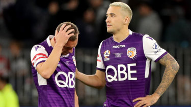 Inconsolable: Brendon Santalab (left with Jason Davidson after losing on penalties.