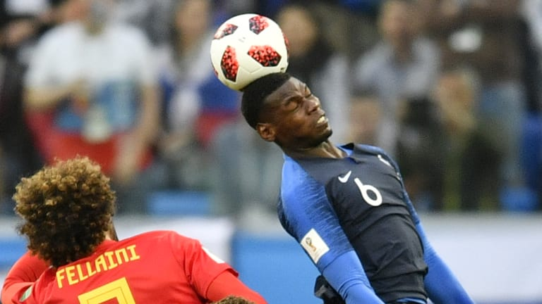 Belgium's Marouane Fellaini and France's Paul Pogba challenge for the ball during their semi-final.