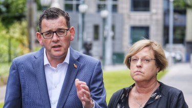 Victorian Premier Daniel Andrews accompanied by Victoria's Police Minister Lisa Neville  give a media conference outside treasury gardens in Melbourne.