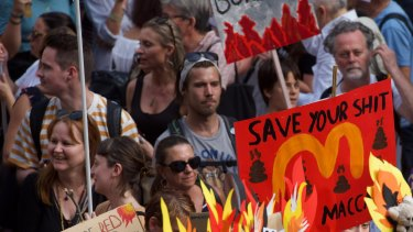 Thousands of protesters rally in front of Sydney Town Hall calling for action on climate change.