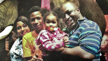 Eric Garner (right), pictured with his family, said 'I can't breathe' 11 times before he died.