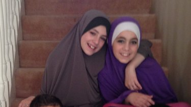 Hoda Sharrouf (right) has begged to be allowed back into Australia. She is pictured with sister Zaynab before leaving the country.