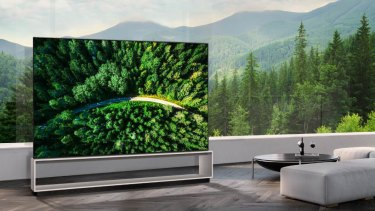 The LG Z9 is a massive TV with a built in stand, speakers and sub woofer.