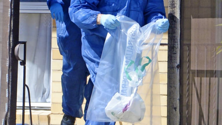Forensics police remove items from the home ofSavas Avan in Shepparton.