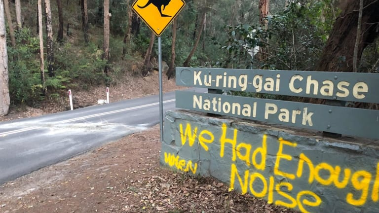 Graffiti near the obstacle suggests it's aimed at motorists.