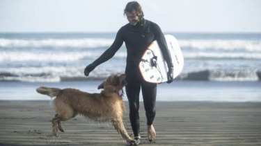 """When Milo spots his """"dad"""" Dayne Maxwell emerging from the sand, it's a flurry of golden-haired excitement."""
