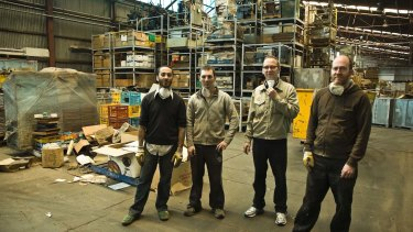 Warren Taylor, far right, Jon Campbell, second from right, and others at Michael Isaachsen's other warehouse in Brooklyn.