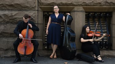Mia Patoulios, CEO of Sydney Youth Orchestras (centre), with principal cello Alisdair Guiney (left) and principal viola Alison Eom (right) outside the former Registrar-General's building in Sydney.