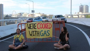 Extinction Rebellion protesters block the Turbot Street off-ramp on the Riverside Expressway in Brisbane City on Wednesday morning.