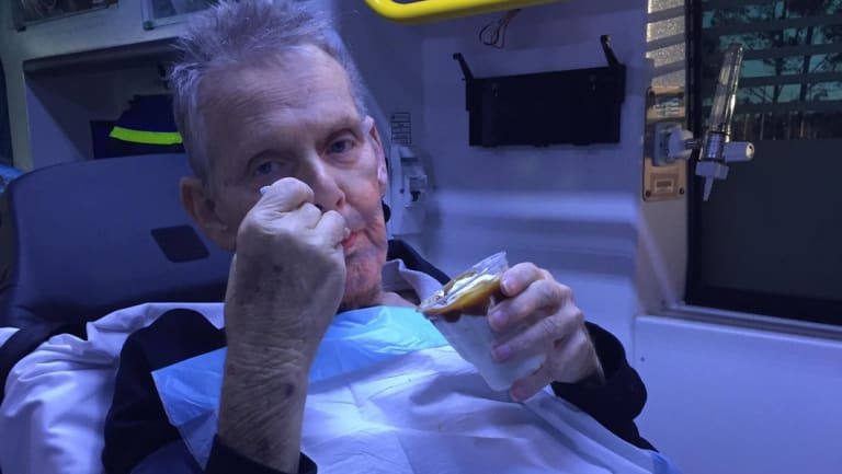 Ron McCartney enjoys a caramel sundae, given to him by ambulance workers.
